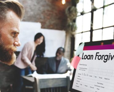 grumpy man looking at loan forgiveness screen