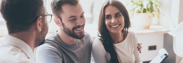 happy couple getting financial advice