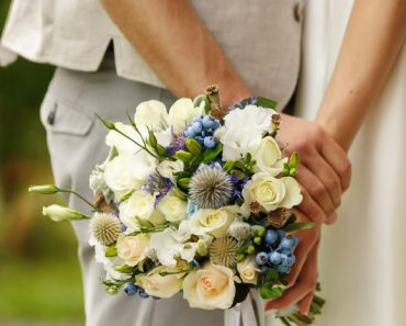 married couple dress flowers and hands