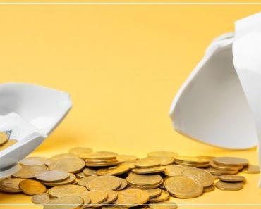 broken piggy bank with money and bright yellow background