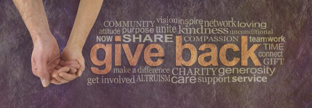 cupped hands with a word jumble in brown, orange and white, community, give back and share