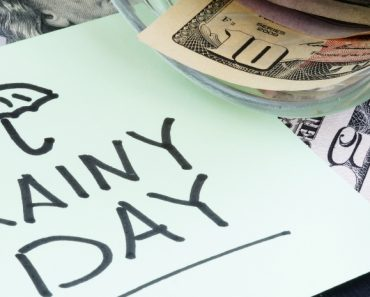 rainy day note with a jar of smaller money bills