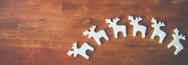 reindeer cutouts on a solid wooden table'