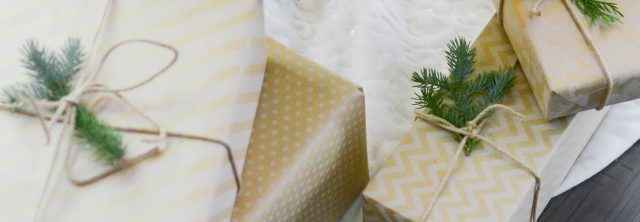 simple wrapped presents with pine accents