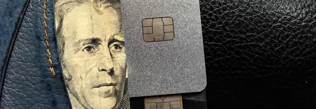 wallet with money and blank credit cards